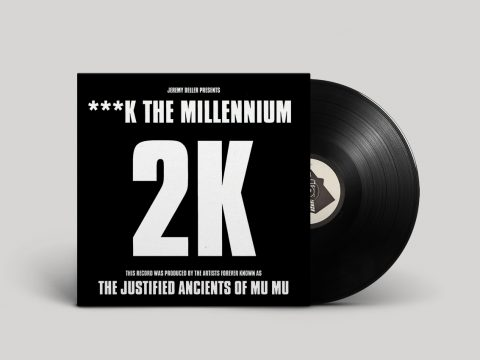 "Black sleeve with white text, announcing ""Jeremy Deller presents Fuck The Millennium"", followed by large 2K logo and note that ""This record was produced by the artists forever known as The Justified Ancients Of Mu Mu"""