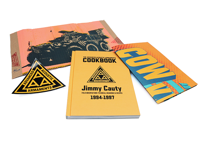 "Contents of the first edition of Jimmy Cauty's ""Advanced Acoustic Armaments Cookbook"", including the Cow Killer poster, a triangular Triple A sticker and a cardboard wrapper."