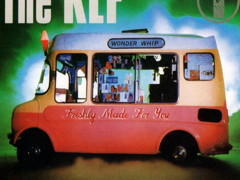 "Front cover scan of The KLF's ""Justified And Ancient"" single, showing the ice cream van with the last remaining copy of their ""1987"" LP in the rear window"